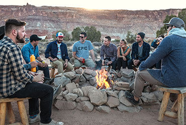 Bachelor Party in desert around camp fire
